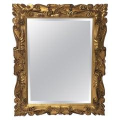Impressive Italian Carved 22-Carat Gold Leaf Giltwood Mirror