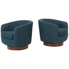 Pair of Milo Baughman Swivel Chairs on Walnut Bases