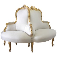 Antique Louis XV Style Giltwood Tete a Tete Settee Upholstered in Natural Linen