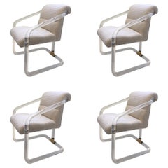 Set of Four Acrylic and Brass Chairs by Lion in Frost