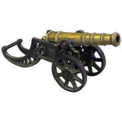Finely Rendered English Victorian Brass Ornamental Cannon on Cast Iron Carriage