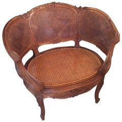 Louis XV Style Walnut Corbeille-Shaped Caned Armchair, 1900s