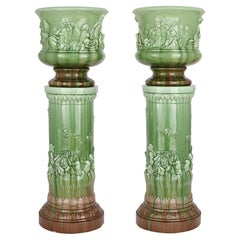 Two Large Renaissance Style Majolica Drip-Glazed Urns on Plinths