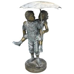 "Life Size Bronze ""Children in the Rain"" Fountain/Sculpture by Jim Davidson"