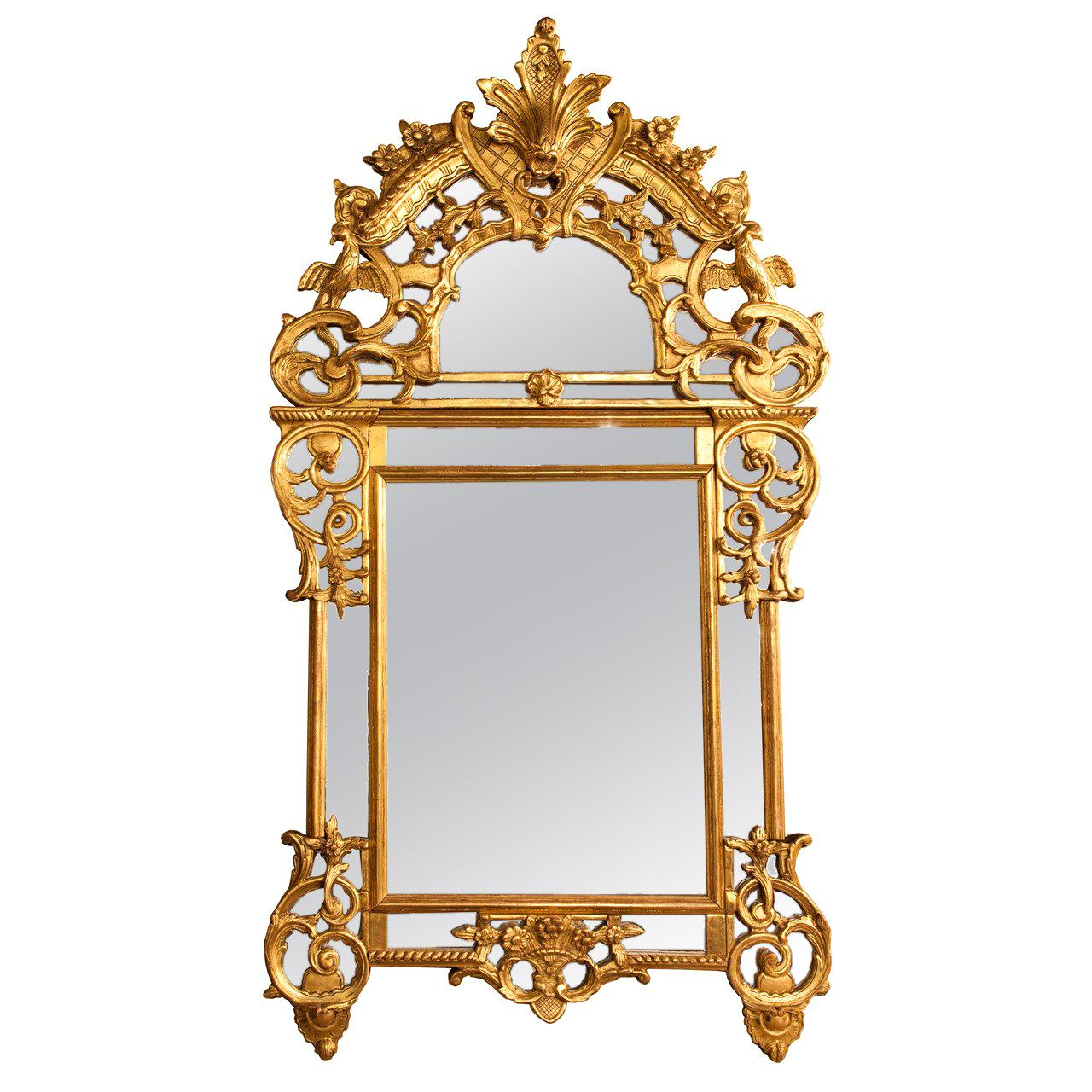 French 19th c regence  style giltwood reticulated footed mirror