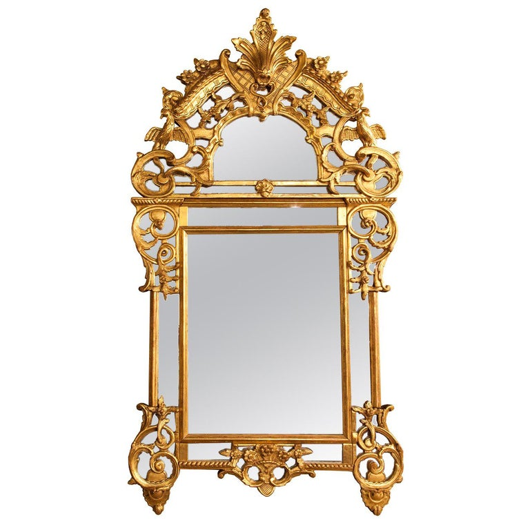 French 19th c regence  style giltwood reticulated footed mirror For Sale