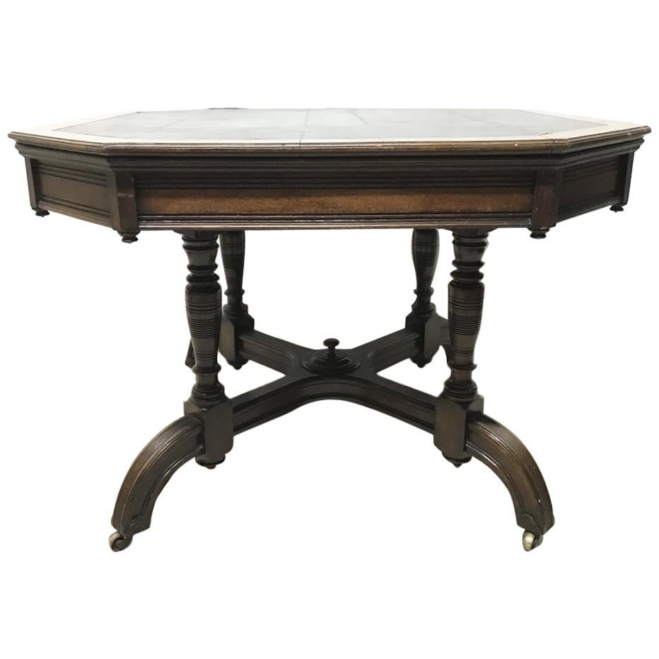 Maple & Co. a Gothic Revival Oak Leather Top Writing Table on Decorative Castors