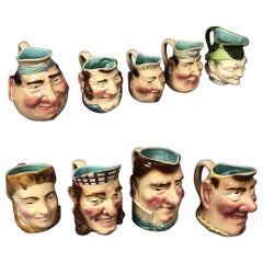 Nine French Majolica Caricature Figural Pitchers, by Sarreguemines