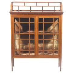 E W Godwin, Collinson & Lock, an Anglo Japanese Mahogany and Satinwood Cabinet