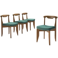 Guillerme et Chambron Set of Four Dining Chairs with Green Upholstery