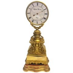 Fine and Rare Patinated and Gilt Bronze Mystery Clock