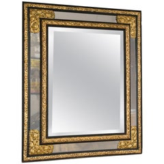 Cushion Mirror with Brass Repousse and Ripple Ebonized Frame