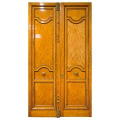 Imposing Pair of Carved Satin Wood Doors