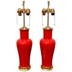 Pair of Vibrant Orange Red Porcelain Lamps on 23-Karat Water Giltwood Bases