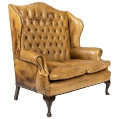 Tufted Leather Wingback Loveseat in the Style of Chippendale