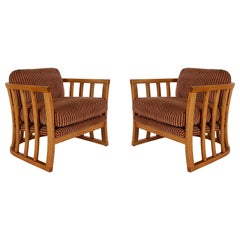 Matching Pair of Mid-Century Modern Spindle Back Barrel Lounge Chairs in Oak