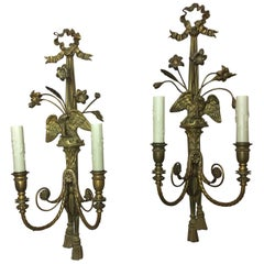 Pair of Three Light Brass Flame Top Motif and Eagle Sconces, Late 19th Century