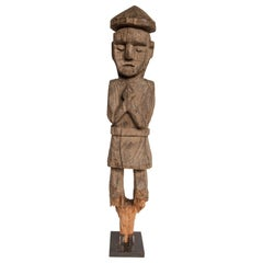 Wooden Tribal Statue from West Nepal, Mid-20th Century, Mounted on a Metal Stand