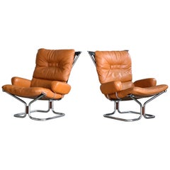 """Pair of Relling Model """"Wing"""" Lounge Chairs and Ottoman in Cognac Leather"""