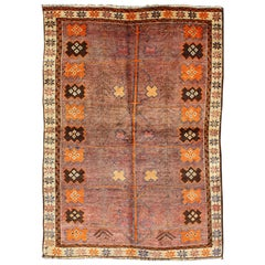 Vintage Persian Gabbeh Rug with Variegated Purple Central Field & Tribal Motifs
