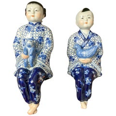 Seated Asian Figures, Pair