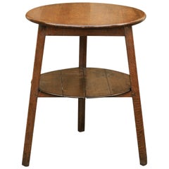 Rustic English 1860s Oak Cricket Table with Splayed Legs, Circular Top and Shelf