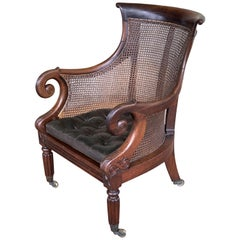 English Bergere Armchair of Caned Mahogany from the Regency Period
