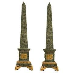 Pair of Large Granite and Gilt Bronze Figural Obelisks