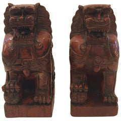 Striking Pair of Carved Wood Foo Dogs in Cinnabar Red