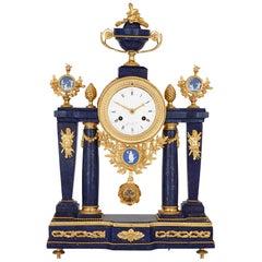 Neoclassical style antique lapis lazuli, jasperware and gilt bronze clock
