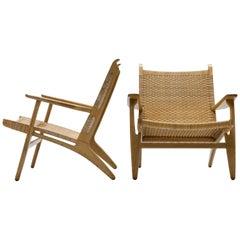 Pair of Cane and Oak Hans Wegner CH27 Lounge Chairs, Carl Hansen & Son