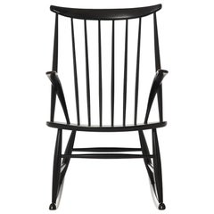 Danish Modern Spindle Backed Wooden Rocking Chair