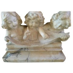 Adolfo Cipriani Carved Marble Musical Sculpture of Three Children Singing