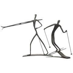 Set of Two Bronze Sculptures of Skiing Figures