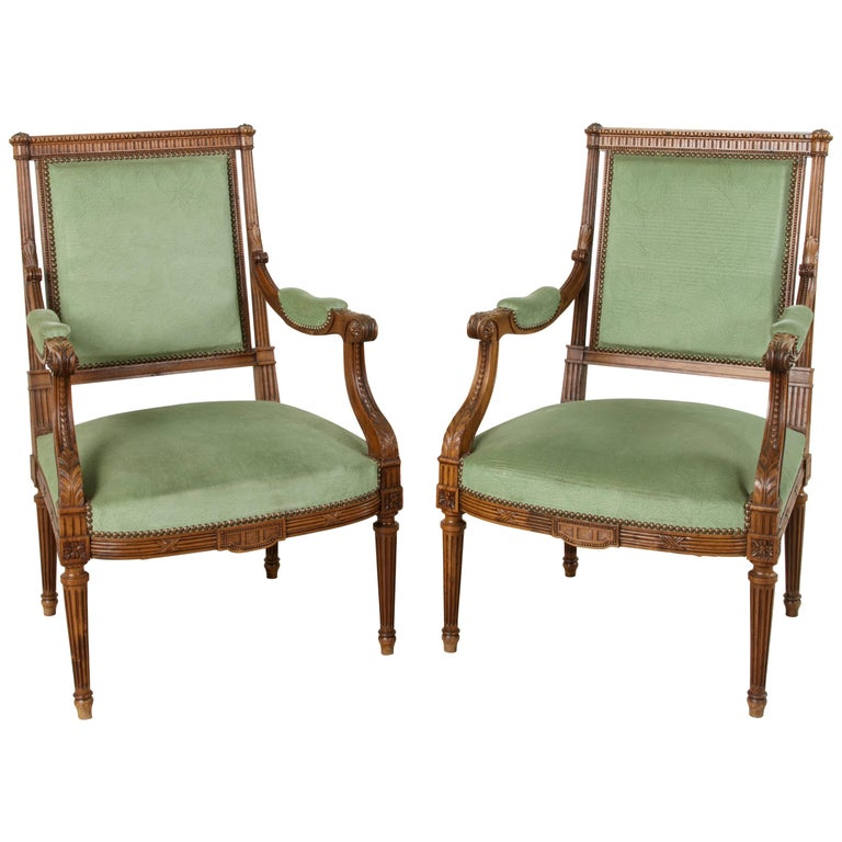 Late 19th Century French Louis XVI Style Hand Carved Walnut Armchairs, Bergeres For Sale