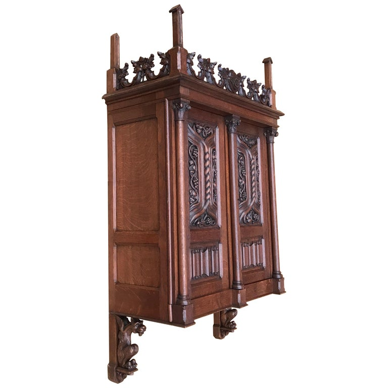 Antique Gothic Revival Hand Carved Oak Wall Cabinet with Gargoyles Sculptures For Sale