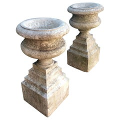 "Pair of French ""Pierre de Cassis"" Tazza Urns on Integrated Plinths"