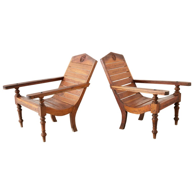 Pair of British Colonial Teak Plantation Chairs For Sale