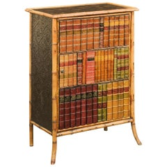 English Late 19th Century Bamboo Single-Door Cabinet with Faux Book Façade