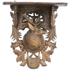 Black Forest 1920s Oak Wall Bracket from Switzerland with Hand Carved Stag Motif