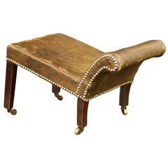 English 1920s Leather Gout Stool with Out-Scrolling Back, Nailheads and Casters