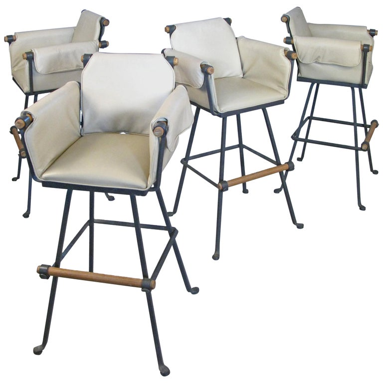 Set of Four Iron and Oak Swivel Barstools by Cleo Baldon For Sale