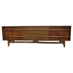 Mid-Century Modern Elongated Low Concave-Front Walnut Credenza