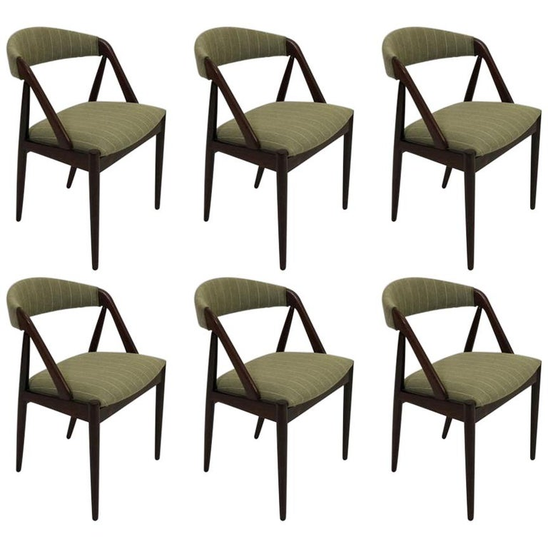1960s Kai Kristiansen Twelve Rosewood Dining Chairs with Upholstery of Choice For Sale