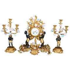 Louis XV Style Gilt Bronze and Porcelain Mounted Clock