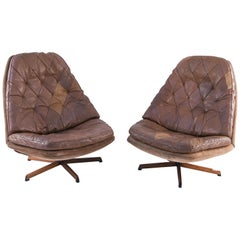 Pair of Madsen and Schubel Leather Upholstered Danish Swivel Chairs