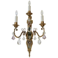 Pair of E. F. Caldwell Gilt Wrought Iron, Mirror and Crystal Sconces