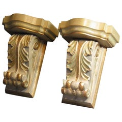 Pair of Painted and Gilt Carved Wood Wall Brackets in the Style of William Kent