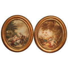 Pair of 19th Century, French Watercolors in Oval Giltwood Frames
