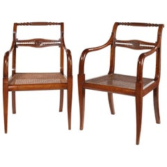 Pair of 19th Century Empire Carved Mahogany Open Armchairs